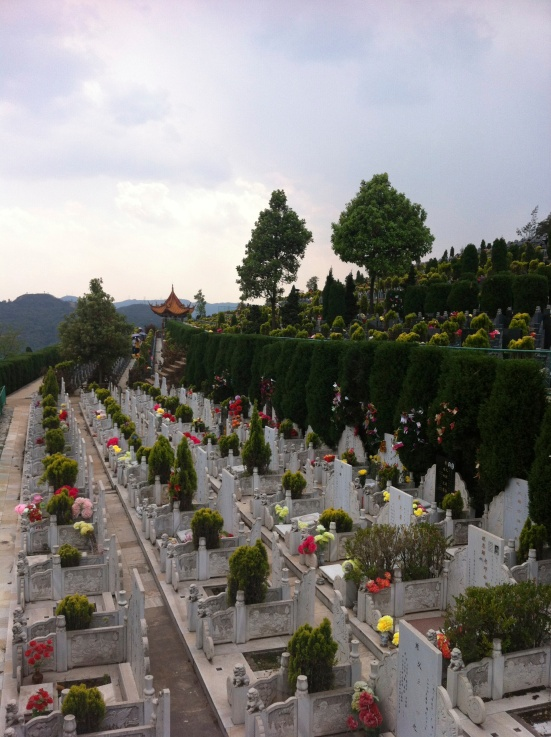 Colorful flowers and food offerings dotting the graves