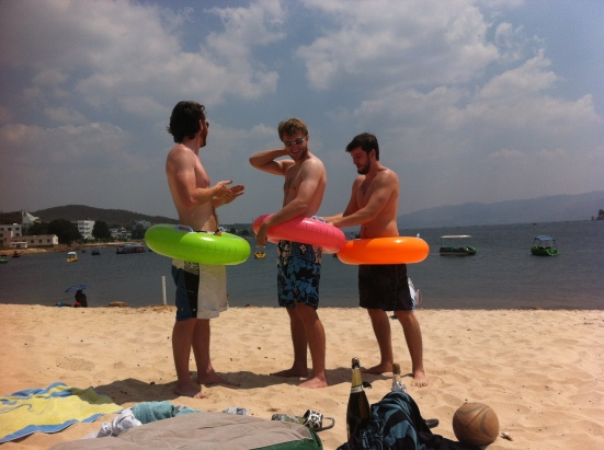 A few of the guys getting sunscreened up before going in the water