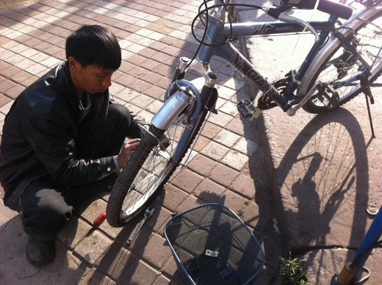 Getting my bike tuned up in Kunming... I only had this bike for a week before it was stolen :(