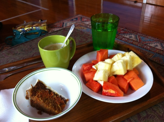 Ideal breakfast- carrot cake, papaya, pineapple, cold water and freshly brewed coffee!